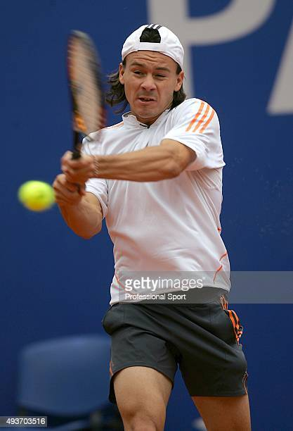 Guillermo Coria of Argentina plays a backhand against Paul-Henri Mathieu of France during the first round of the ATP Masters Series at the Monte...