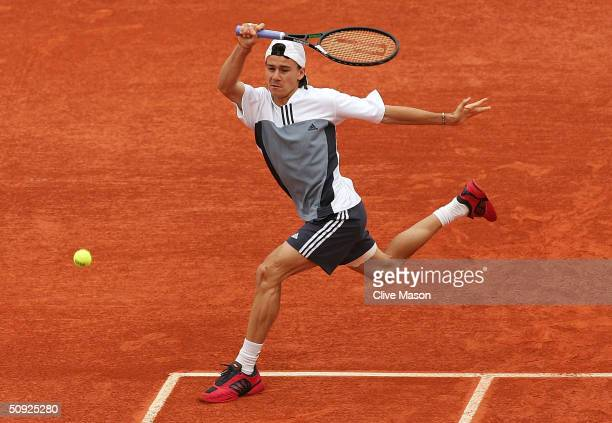 Guillermo Coria of Argentina returns in his semifinal match against Tim Henman of Great Britain during Day Twelve of the 2004 French Open Tennis...