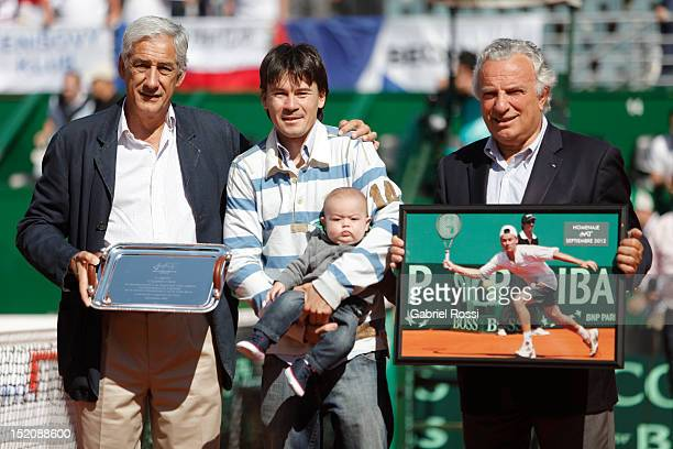 Guillermo Coria of Argentina with his son receives an mention after the match between Argentina and Czech Republic as part of the third day of the...