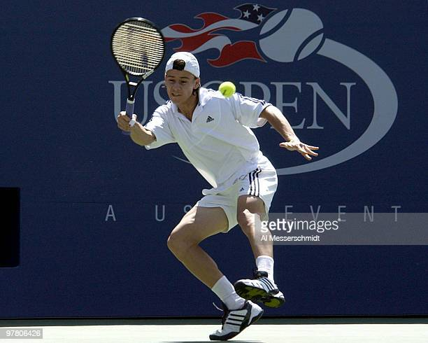 Guillermo Coria returns a forehand during a three-set, quarter final loss to Andre Agassi Friday, September 5, 2003 at the U. S. Open, New York.