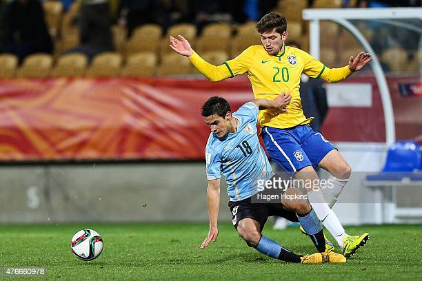 Guillermo Cotugno of Uruguay and Jean Carlos of Brazil compete for the ball during the FIFA U20 World Cup New Zealand 2015 Round of 16 match between...