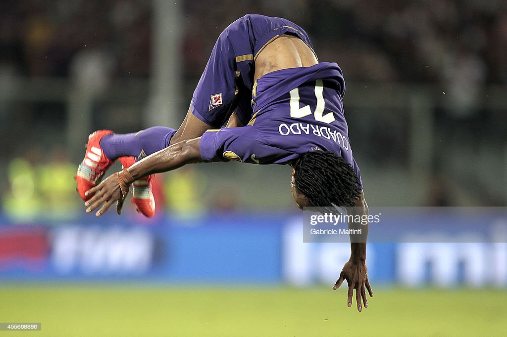 Guillermo Cuadrado of ACF Fiorentina celebrates after scoring a goal during the UEFA Europa League group K match between ACF Fiorentina and EA Guingamp at Stadio Artemio Franchi on September 18, 2014 in Florence, Italy.