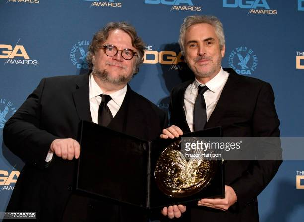 Guillermo del Toro and 2018 DGA Feature Film Award winner for 'Roma' Alfonso Cuaron pose in the press room during the 71st Annual Directors Guild Of...