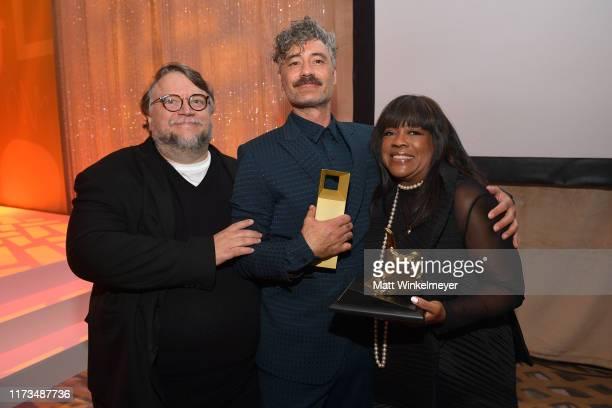 Guillermo del Toro and Chaz Ebert present Taika Waititi the TIFF Ebert Director Award during the 2019 Toronto International Film Festival TIFF...