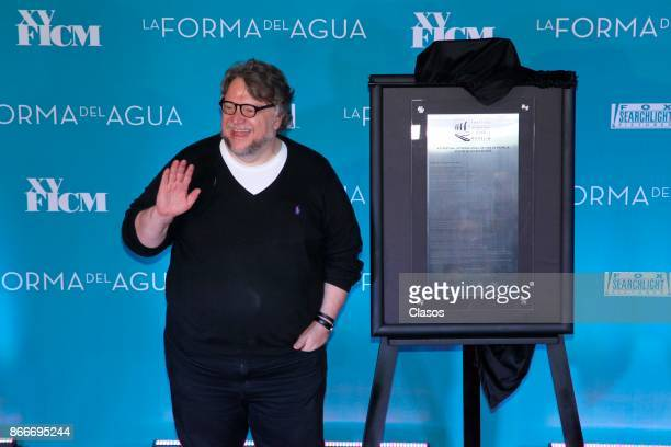 Guillermo del Toro poses a commemorative plaque of the Festival during the red carpet of 'The Shape of Water' as part of the XV Morelia International...