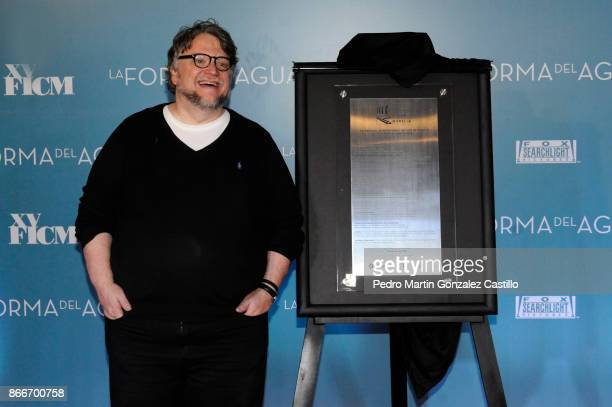 Guillermo del Toro poses with the commemorative plaque of the Festival during the red carpet of 'The Shape of Water' as part of the XV Morelia...