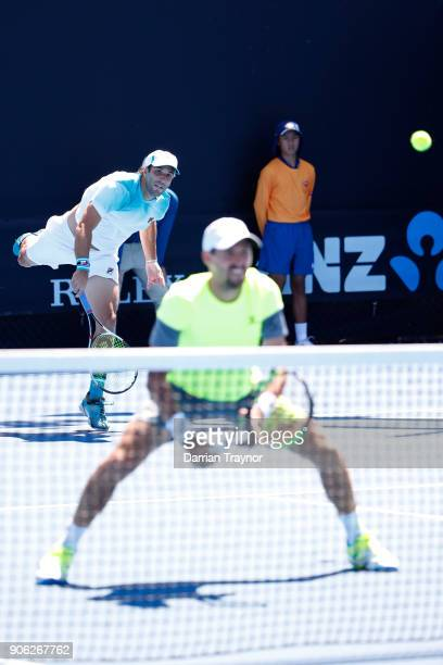 Guillermo Duran of Argentina serves in his first round men's doubles match with Andres Molteni of Argentina against JeanJulien Rojer of the...