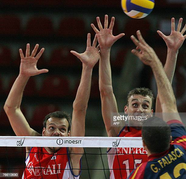 Guillermo Falasca of Spain hits a ball as Vincent Montmeat and Guillaume Samica of France block during their 2007 Men's European Championships...