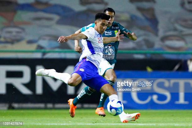 Guillermo Fernandez of Cruz Azul kicks the ball as Jose Ramirez of Leon chases during the 8th round match between Leon and Cruz Azul as part of the...