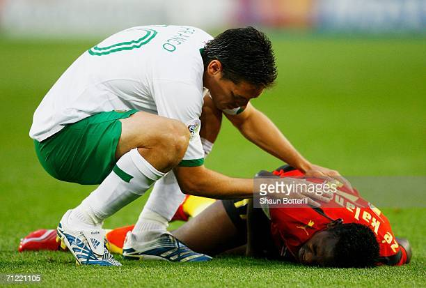 Guillermo Franco of Mexico attends to Ze Kalanga of Angola during the FIFA World Cup Germany 2006 Group D match between Mexico and Angola played at...