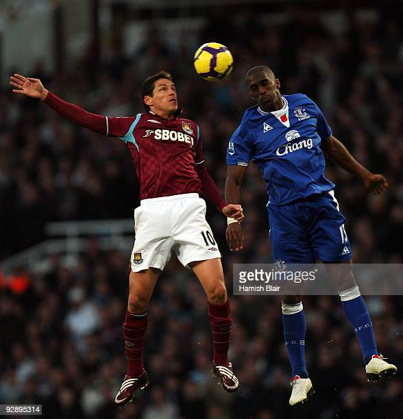 Guillermo Franco of West Ham and Sylvain Distin of Everton go for the header during the Barclays Premier League match between West Ham United and...