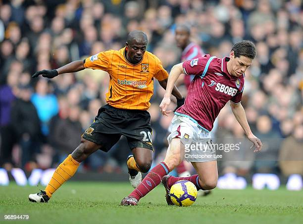 Guillermo Franco of West Ham turns away from George Boateng of Hull during the Barclays Premier League match between West Ham United and Hull City at...