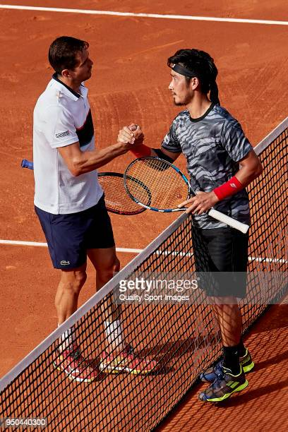 Guillermo García López of Spain and Yuichi Sugita of Japan look on during first day of the Barcelona Open Banc Sabadell at the Real Club de Tenis...