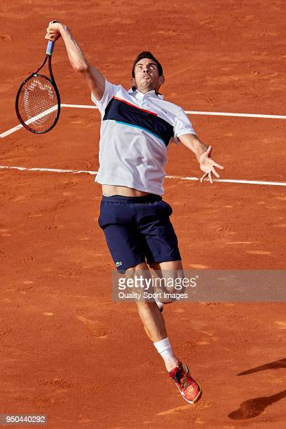 Guillermo García López of Spain in action against Yuichi Sugita of Japan during first day of the Barcelona Open Banc Sabadell at the Real Club de...
