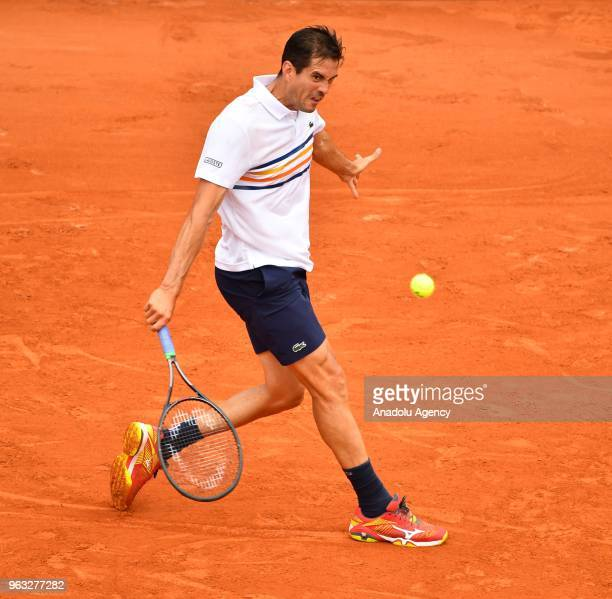 Guillermo García-Lopez of Spain in action against Stan Wawrinka of Switzerland during their first round match at the French Open tennis tournament at...