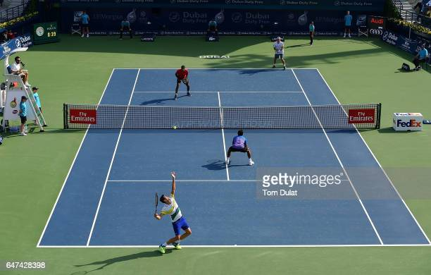 Guillermo Garcia-Lopez of Spain and Leander Paes of India in action against Rohan Bopanna of India and Marcin Matkowski of Poland during their semi...