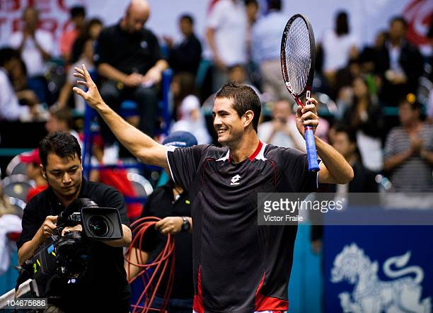 Guillermo GarciaLopez of Spain celebrates match point in the singles final match against Jarkko Nieminen of Finland on Day 9 of the PTT Thailand Open...