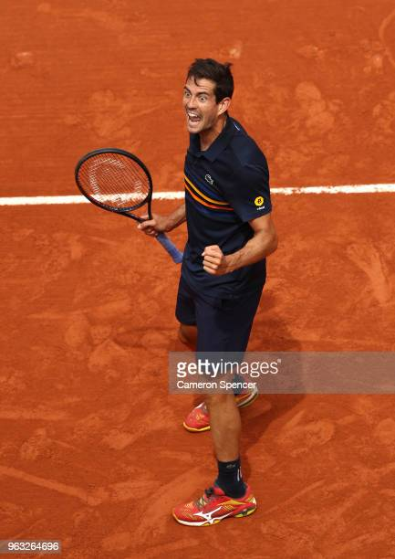 Guillermo Garcia-Lopez of Spain celebrates victory duirng the mens singles first round match against Stan Wawrinka of Switzerland during day two of...