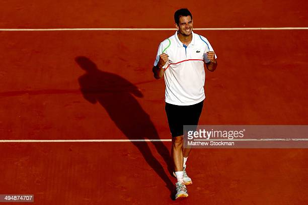 Guillermo Garcia-Lopez of Spain celebrates victory in his men's singles match against Donald Young of the United States on day seven of the French...