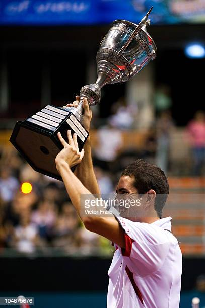Guillermo Garcia-Lopez of Spain celebrates with the trophy after winning the singles final match against Jarkko Nieminen of Finland on Day 9 of the...