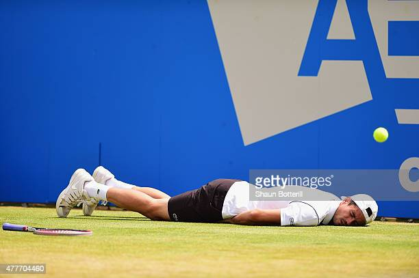 Guillermo GarciaLopez of Spain falls to the ground in his men's singles quarterfinal match against Kevin Anderson of South Africa during day five of...