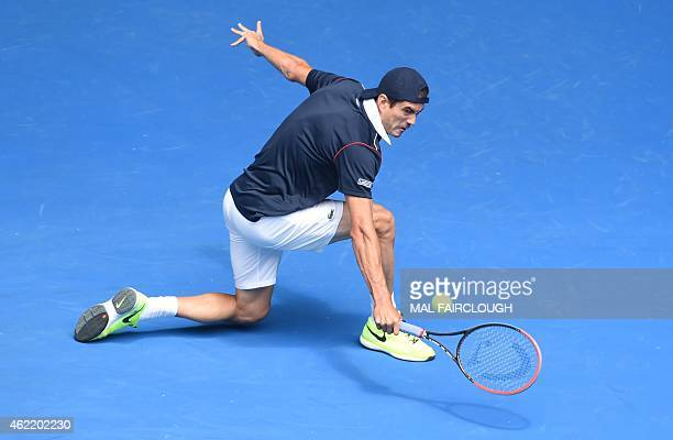 Guillermo Garcia-Lopez of Spain hits a return against Stan Wawrinka of Switzerland in their men's singles match on day eight of the 2015 Australian...