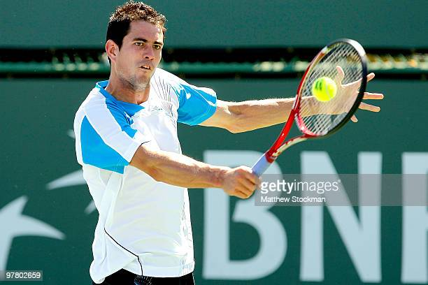Guillermo Garcia-Lopez of Spain Juan Monaco of Argentina during the BNP Paribas Open on March 17, 2010 at the Indian Wells Tennis Garden in Indian...