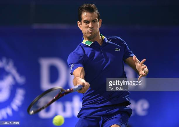 Guillermo Garcia-Lopez of Spain plays a forehand during his second round match against Andy Murray of Great Britain on day four of the ATP Dubai Duty...