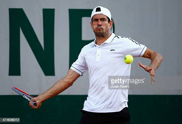 Guillermo Garcia-Lopez of Spain plays a forehand in his Men's Singles match against Steve Johnson of the United States on day one of the 2015 French...
