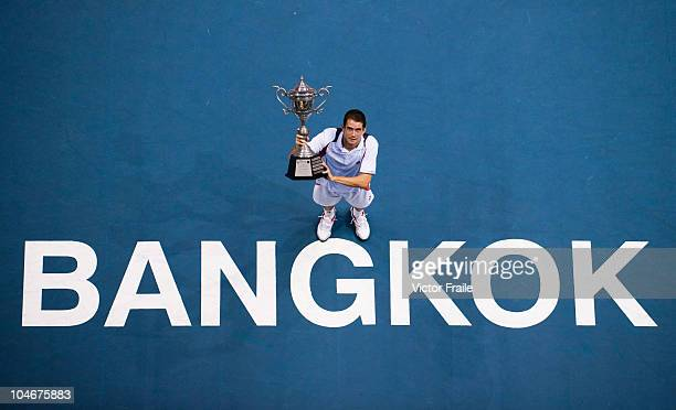 Guillermo Garcia-Lopez of Spain poses with the trophy after winning the singles final match against Jarkko Nieminen of Finland on Day 9 of the PTT...