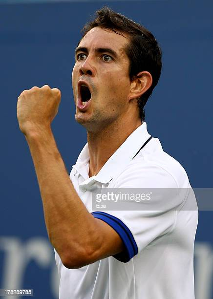 Guillermo GarciaLopez of Spain reacts after winning the second set against Juan Martin Del Potro of Argentina during their men's singles first round...