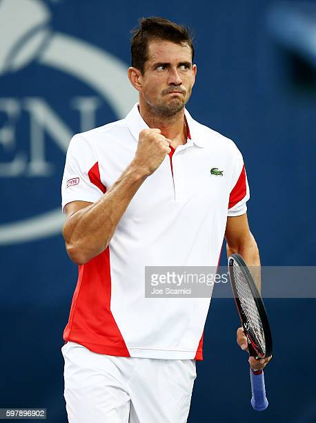 Guillermo Garcia-Lopez of Spain reacts against Roberto Bautista Agut of Spain during his first round Men's Singles match on Day One of the 2016 US...