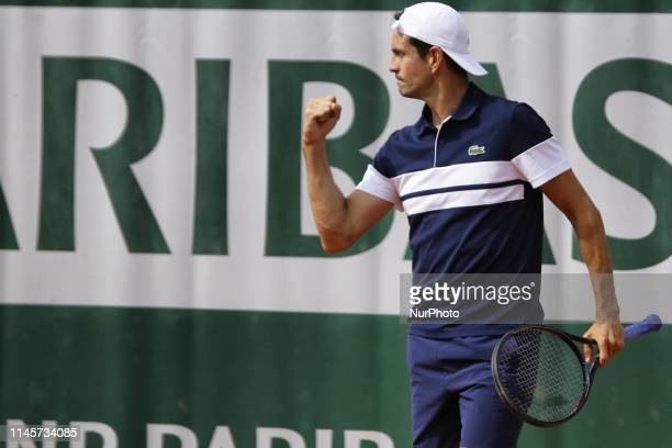 Guillermo Garcia-Lopez of Spain reacts during a match against Oscar Otte of Germany in the third round qualifications of Roland Garros, in Paris,...
