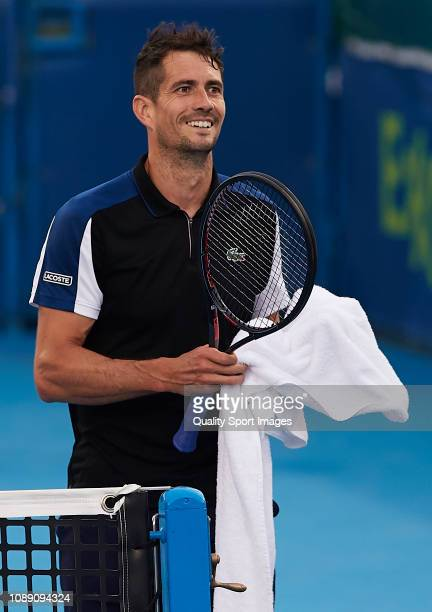 Guillermo Garcia-Lopez of Spain reacts during his match against Roberto Bautista of Spain during day three of the ATP Qatar ExxonMobil Open at...