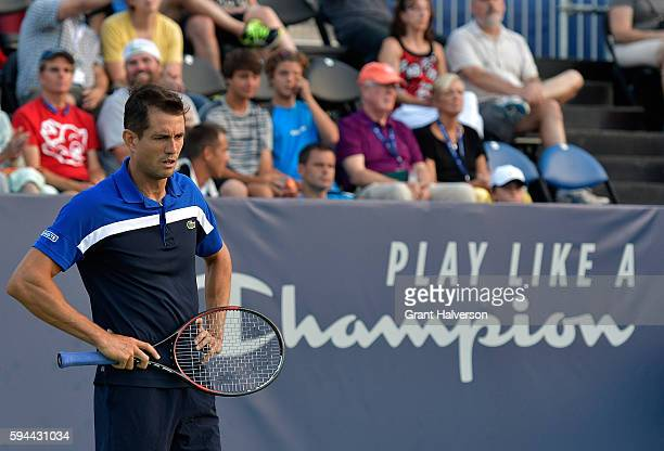 Guillermo Garcia-Lopez of Spain reacts in his match against Sam Querrey of the United States during the Winston-Salem Open at Wake Forest University...