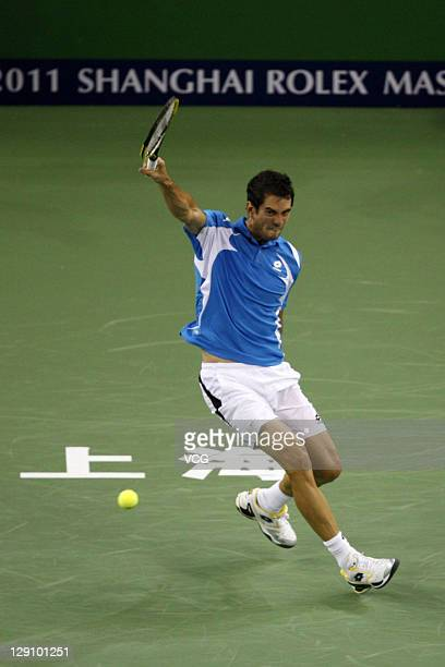 Guillermo Garcia-Lopez of Spain returns a ball to Rafael Nadal of Spain during day three of the 2011 Shanghai Rolex Masters at the Qi Zhong Tennis...