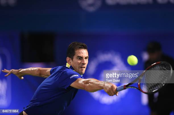 Guillermo Garcia-Lopez of Spain returns a shot during his second round match against Andy Murray of Great Britain on day four of the ATP Dubai Duty...