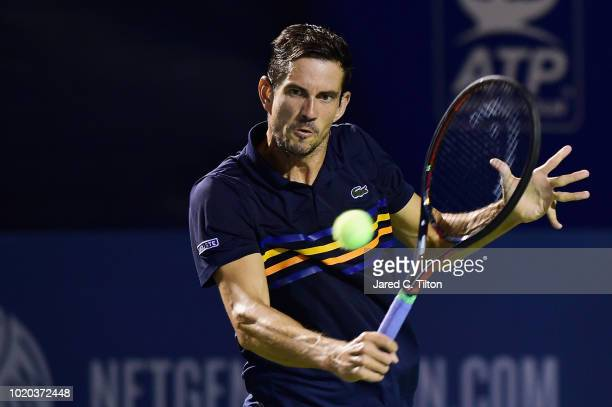 Guillermo Garcia-Lopez of Spain returns a shot from Hyeon Chung of Korea during the first day of the Winston-Salem Open at Wake Forest University on...