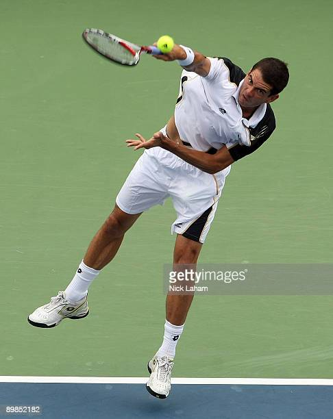 Guillermo GarciaLopez of Spain serves against Fernando Verdasco of Spain during day two of the Western Southern Financial Group Masters on August 17...