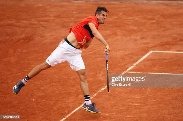 Guillermo Garcia-Lopez of Spain serves during the men's singles first round match against Gilles Muller of Luxembourg on day one of the 2017 French...