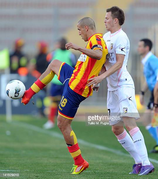 Guillermo Giacomazzi of Lecce and Josip Ilicic of Palermo compete for the ball during the Serie A match between US Lecce and US Citta di Palermo at...