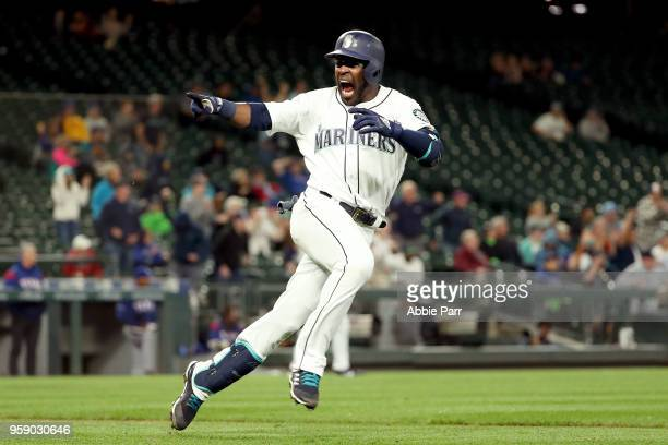 Guillermo Heredia celebrates after hitting a single in the eleventh inning to beat the Texas Rangers 98 during their game at Safeco Field on May 15...