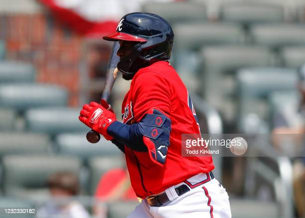 Guillermo Heredia of the Atlanta Braves is hit by a pitch in the sixth inning of an MLB game against the Miami Marlins at Truist Park on April 15,...