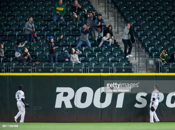 Guillermo Heredia of the Seattle Mariners and Mitch Haniger of the Seattle Mariners watch the home run by ShinSoo Choo of the Texas Rangers fly into...