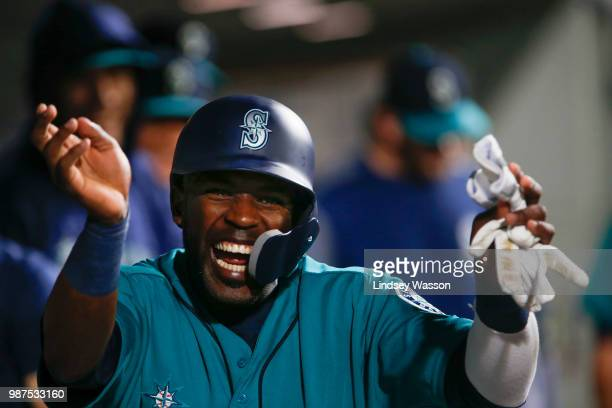 Guillermo Heredia of the Seattle Mariners celebrates in the dugout after scoring on a single by Jean Segura in the seventh inning against the Kansas...
