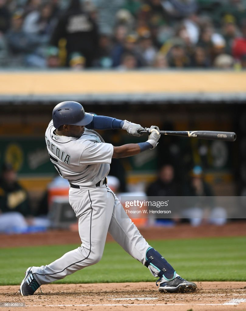 Guillermo Heredia #5 of the Seattle Mariners hits a double against the Oakland Athletics in the top of the fourth inning at the Oakland Alameda Coliseum on May 23, 2018 in Oakland, California.
