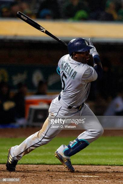 Guillermo Heredia of the Seattle Mariners hits an RBI double against the Oakland Athletics during the tenth inning at the Oakland Coliseum on May 22...