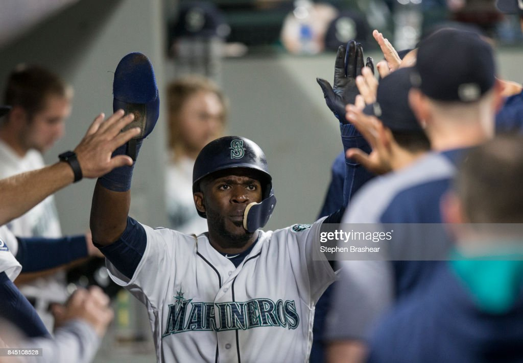 Guillermo Heredia #5 of the Seattle Mariners is congratulated by teammates after scoring a run on a single by Jean Segura #2 of the Seattle Mariners off of relief pitcher Jesse Chavez #40 of the Los Angeles Angels of Anaheim during the fourth inning of a game at Safeco Field on September 9, 2017 in Seattle, Washington.