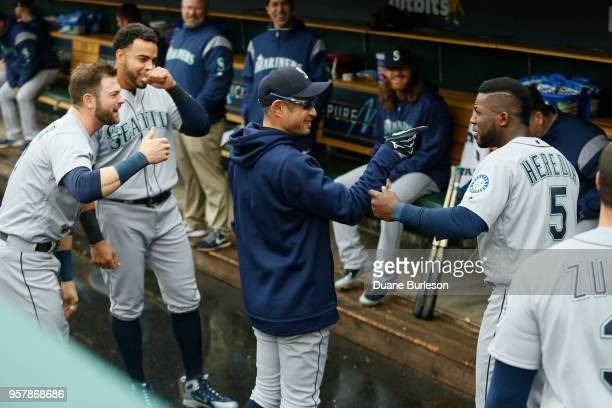 Guillermo Heredia of the Seattle Mariners jokes with interim bench coach Ichiro Suzuki of the Seattle Mariners before game one of a doubleheader...