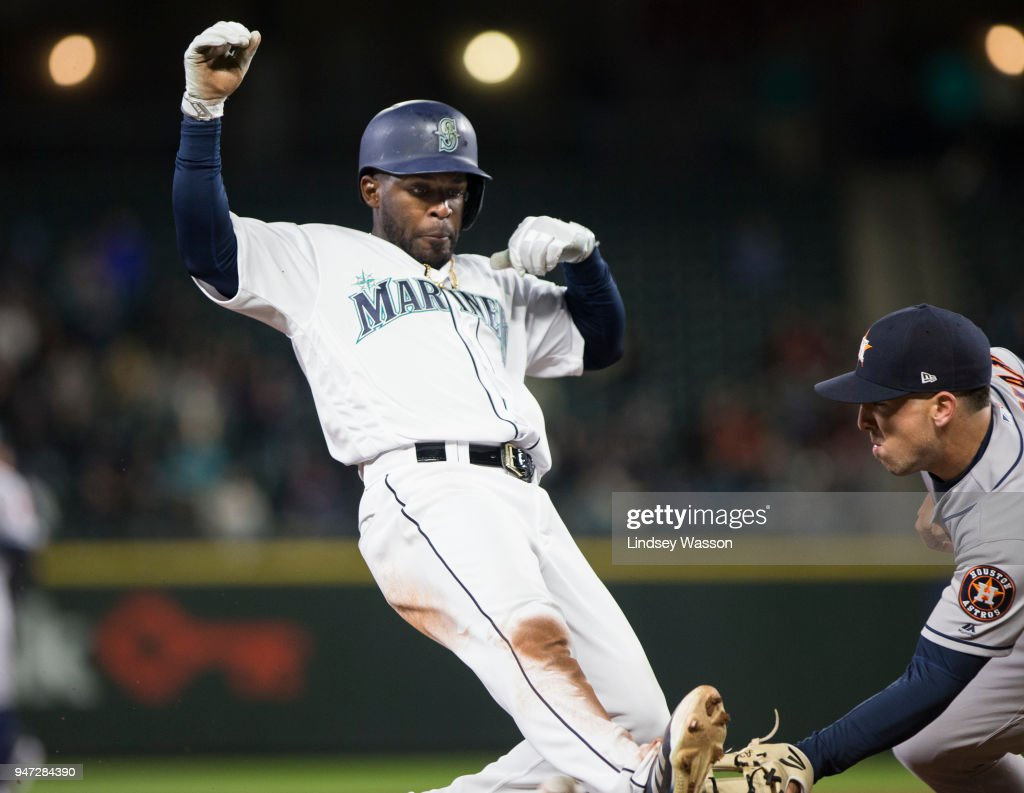 Guillermo Heredia #5 of the Seattle Mariners narrowly beats the tag at third base from Alex Bregman #2 of the Houston Astros in the seventh inning at Safeco Field on April 16, 2018 in Seattle, Washington. The Seattle Mariners beat the Houston Astros 2-1.